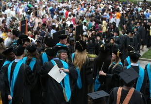 Students celebrate following the graduate and undergraduate commencement Saturday May 5, 2018 in Gainesville, Ga. (Jason Getz for Brenau University)