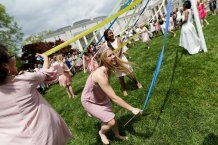 Mason Garland wraps the Maypole (AJ Reynolds/Brenau University)