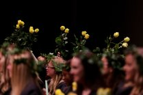 Seniors wave their roses along to the sophomore class song at Class Day. (AJ Reynolds/Brenau University)