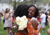 The May Queen Simone Lewis hugs a friend after the May Day Celebration during the Alumnae Reunion Weekend & May Day at Brenau University Saturday, April 14, 2018, in Gainesville, Ga. Photo by Jason Getz / Brenau University