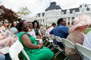 Family members and friends cheer for members of the May Court. (AJ Reynolds/Brenau University)
