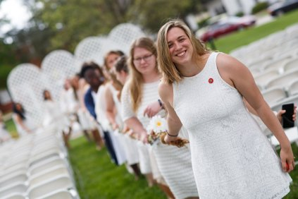 Devin Horan leads the junior class as they carry the daisy chain toward the Crow's Nest during Class Day. (AJ Reynolds/Brenau University)