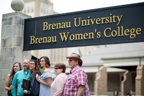 Laretta Boyd smiles with family after receiving a Bachelor of Science in early childhood education at the 2018 Spring Commencement Ceremony on Saturday, May 5, on Brenau University's historic Gainesville campus. (Nick Bowman for Brenau University)