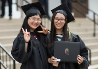 "Ling ""Becky"" Xu (left) and Xingyi ""Lisa"" Wang smile after the 2018 Spring Commencement Ceremony on Saturday, May 5, on Brenau University's historic Gainesville campus. (Nick Bowman for Brenau University)"
