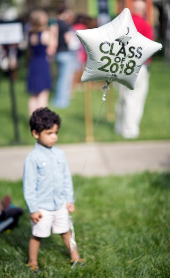 A child holds a balloon at the 2018 Spring Commencement Ceremony on Saturday, May 5, on Brenau University's historic Gainesville campus. (Nick Bowman for Brenau University)