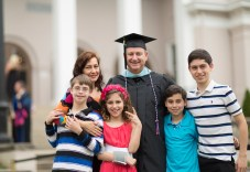 Randal Robison, MAT, smiles with his family prior to the 2018 Spring Commencement Ceremony on Saturday, May 5, on Brenau University's historic Gainesville campus. (Nick Bowman for Brenau University)