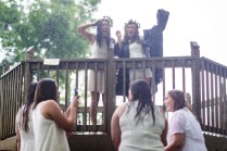 Daniella Santiago and Alyssa Eblen get rained on during Class Day in the Crow's Nest
