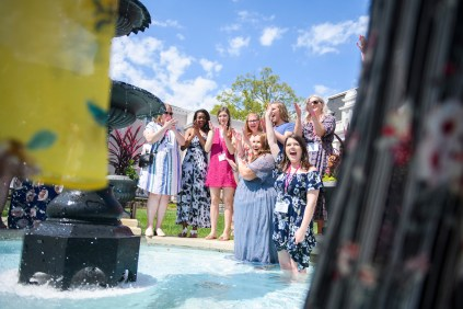 Devon Adams, left, and Meg Bronaugh celebrate their engagements in Grace Hooten Moore Memorial Fountain with their Delta Delta Delta sorority sisters.