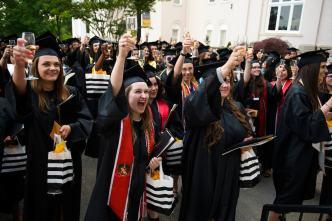 Women's College graduates toast Ed Schrader