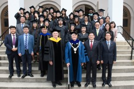 Officials from Brenau University and Anhui Normal University pose with graduating 2+2 students.