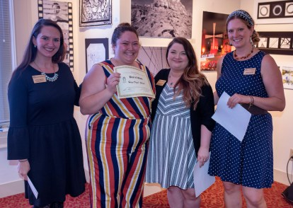 Brenau University's Hope Vigil-Shuck is awarded the best in show during the collaborative opening reception. From the left they are Gallery Director Nichole Rawlings, Vigil-Shuck, Assistant Gallery Director Allison Lauricella and Art and Design Department Chair Claudia Wilburn.