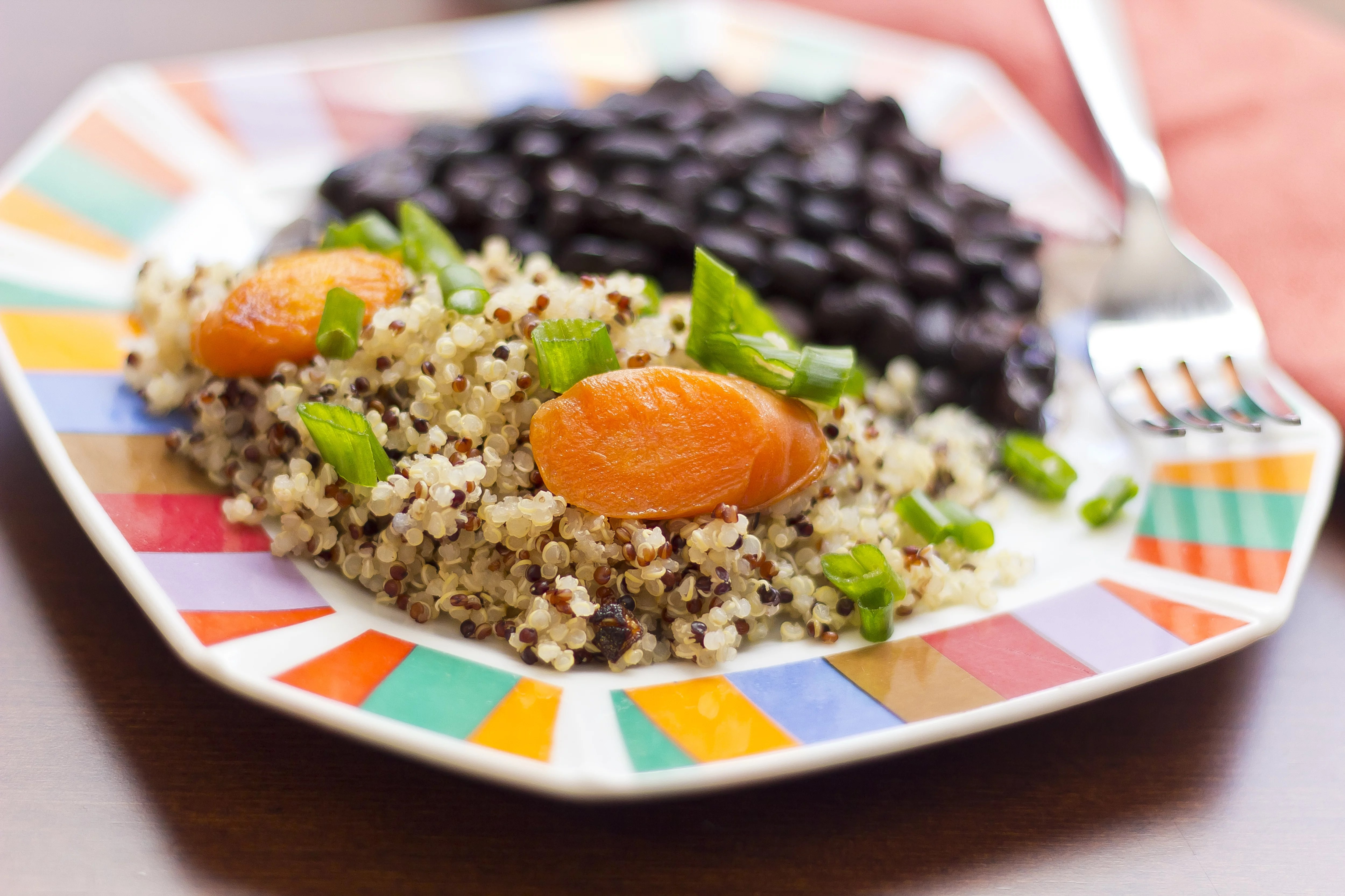 Healthy nutty Quinoa and Carrot Salad and scallions with black beans