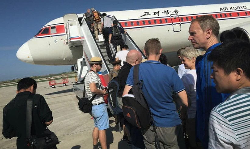In this Saturday, June 27, 2015, photo, passengers board an Air Koryo plane at the Pyongyang International Airport, in Pyongyang, North Korea. Air Koryo is the only carrier to have been awarded just one star in rankings released recently by the UK-based SkyTrax consultancy agency. (AP Photo/Wong Maye-E)