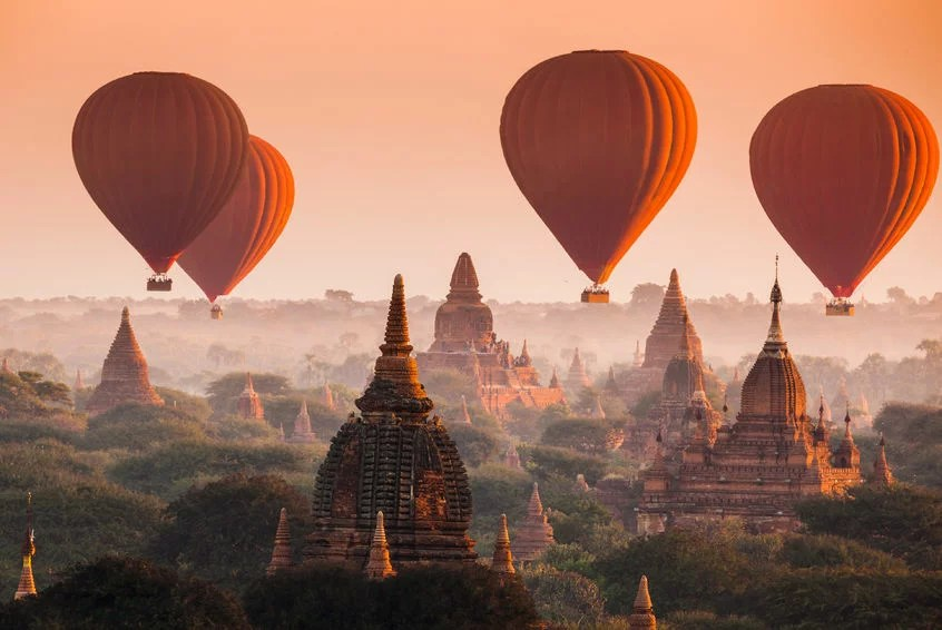 35498286 - hot air balloon over plain of bagan in misty morning, myanmar