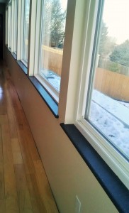 Dark window sills against creamy walls