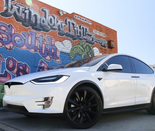 White Tesla Chrome Delete