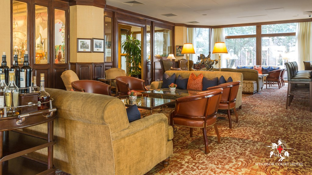 Plush and leather seating inside the Polo Club Lounge at Windsor Court Custom Zoom Background