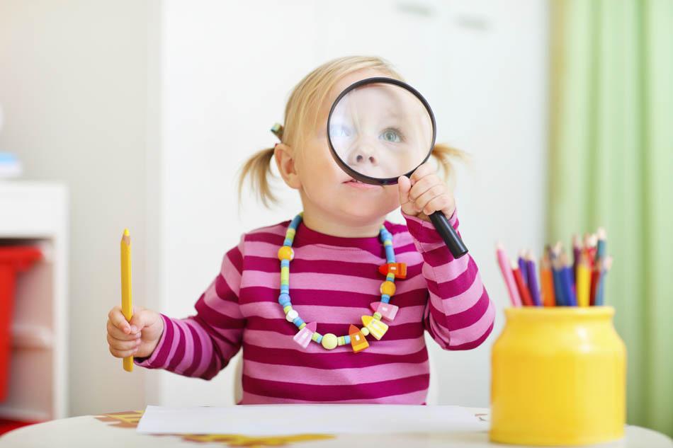 toddler-girl-looking-through-magnifying-glass