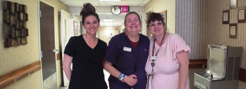 Nurses and Aides standing in N hall.