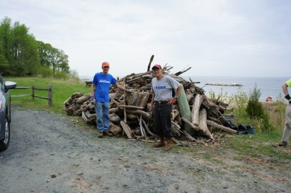 Gordon and Bob with the finished pile of logs.