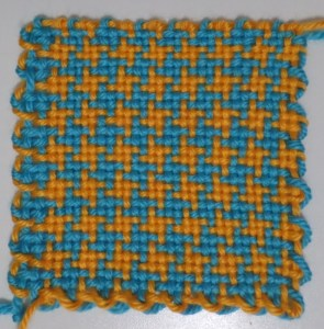 The finished square off the loom. Lower left knots are not yet untied. Notice how the lower right corner yarns are not interlocked. Live and learn.
