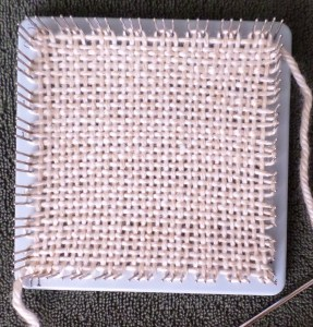 This is a photo of my very first pin loom square.