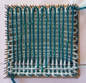 Row 3: take the beads from strands #7 and 9 U-3 according to pattern directions. Note that the L2 rows frame the R2 bead--one below and one above.