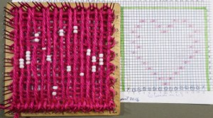 Plain weaving the first row before you arrange the beads helps keep the warped yarn a little more firmly in place on the loom.