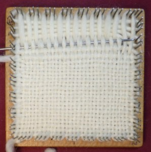 Square in progress. Notice the slanted fell line. The needle doesn't want to exit the row in the right place.