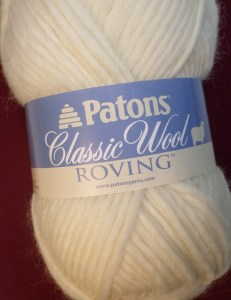 Patons Classic Wool Roving yarn. It has twist, so it won't tear apart easily. It's pretty and smooth--a dream to weave with, but not on this loom (unless you like nightmares).