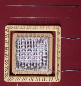 "The 2.5"" x 2.5"" loom nesting inside the 4"" x 4"" Weave-it. And a look at the two needles."