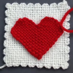 "I think this must be the larger HazelRose sweetheart because it's about 4 inches across (shown on a 4"" x 4"" woven square)."