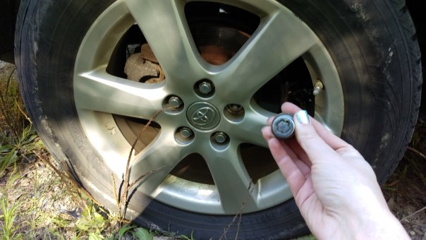 Tire with one lug nut removed