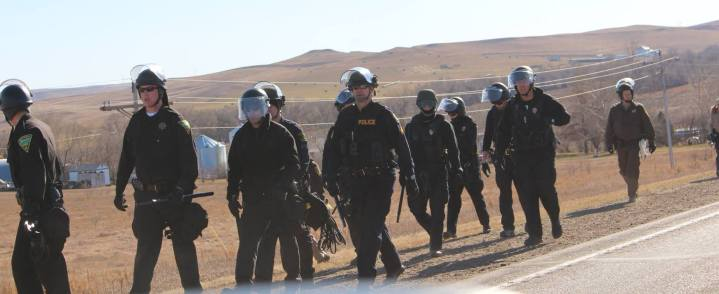 dozens of law enforcement geared to the teeth!