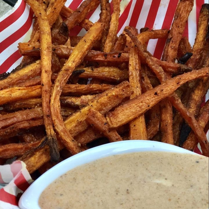 Healthy & Crispy homemade baked carrot fries with dipping sauce