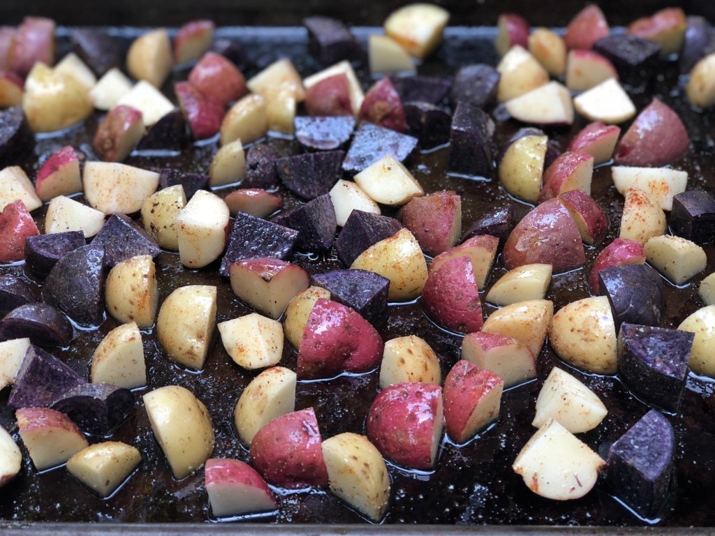 Baby Potatoes tossed in olive oil and spices for roasted honey mustard potato salad