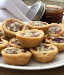 mini holiday appetizers with rosemary shortbread , date jam & gorgonzola
