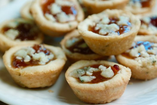 savory mini tart appetizers with rosemary shortbread filled with date jam and topped with gorgonzola cheese-perfect make ahead appetizers