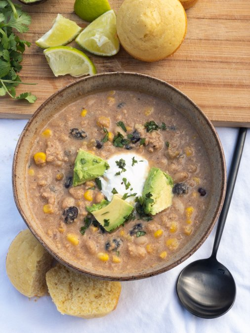A simple and healthy chili recipe, this easy crockpot white chicken chili with corn and beans is the perfect meal for a crowd. It's light yet creamy, low fat and packed with flavor.