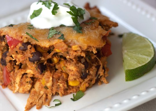 Mexican casserole made with cauliflower rice, shredded chicken, black beans and corn. Topped with cheese, sour cream and cilantro. Served with a squeeze of lime. An easy and low carb family dinner!