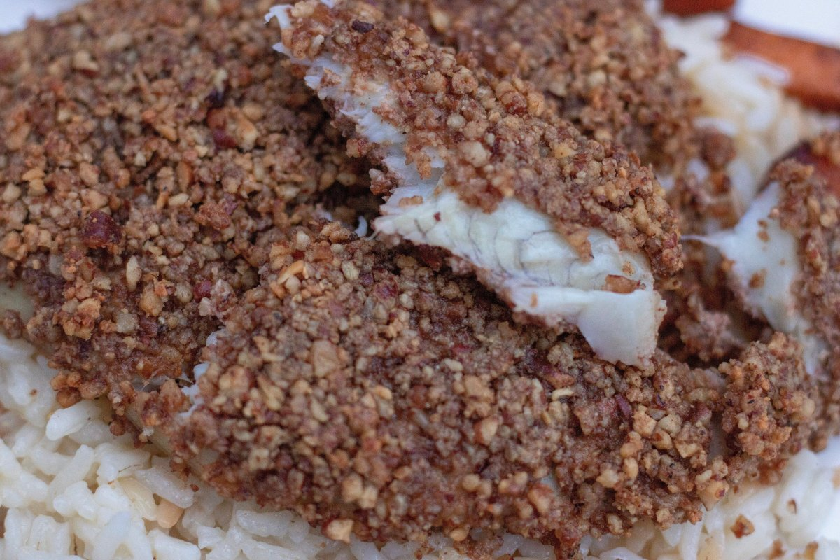flaky and moist white fish is crusted with toasted pecans and parmesan cheese. It's served over rice pilaf.