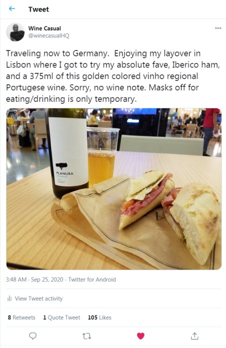 Ibérico ham sandwich and Vinho Regional Alentejano Portuguese wine photo I tweeted out while in the Lisbon airport food court during the pandemic.