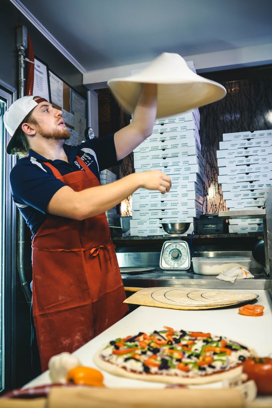 man making pizza dough