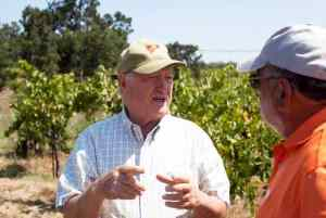 Joe Battaglini with Mills Book Club member Mike in the vineyards
