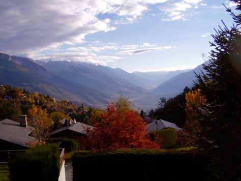 The stunning early autumn view of the upper Rhone River Valley from Chalet Petite Tara in Bluche, Valais.
