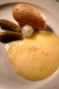 Holy Trinity of Valais - Molten raclette, potatoes and pickles.