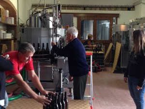 Three generations of Grassos in the bottling room at Ca' del Baio (left to right: Giullio, his father Ernesto, Paola Grasso Deltetto (background) and Federica)