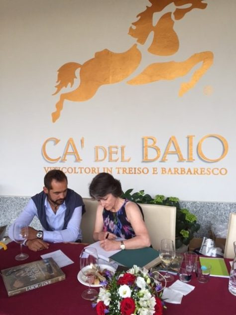 Signing vintner Giuliano Iuorio's book at Cà del Baio. What a thrill for me!