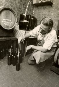 Meo Zuech filling bottles at his home winery in Westlake Village, 1978