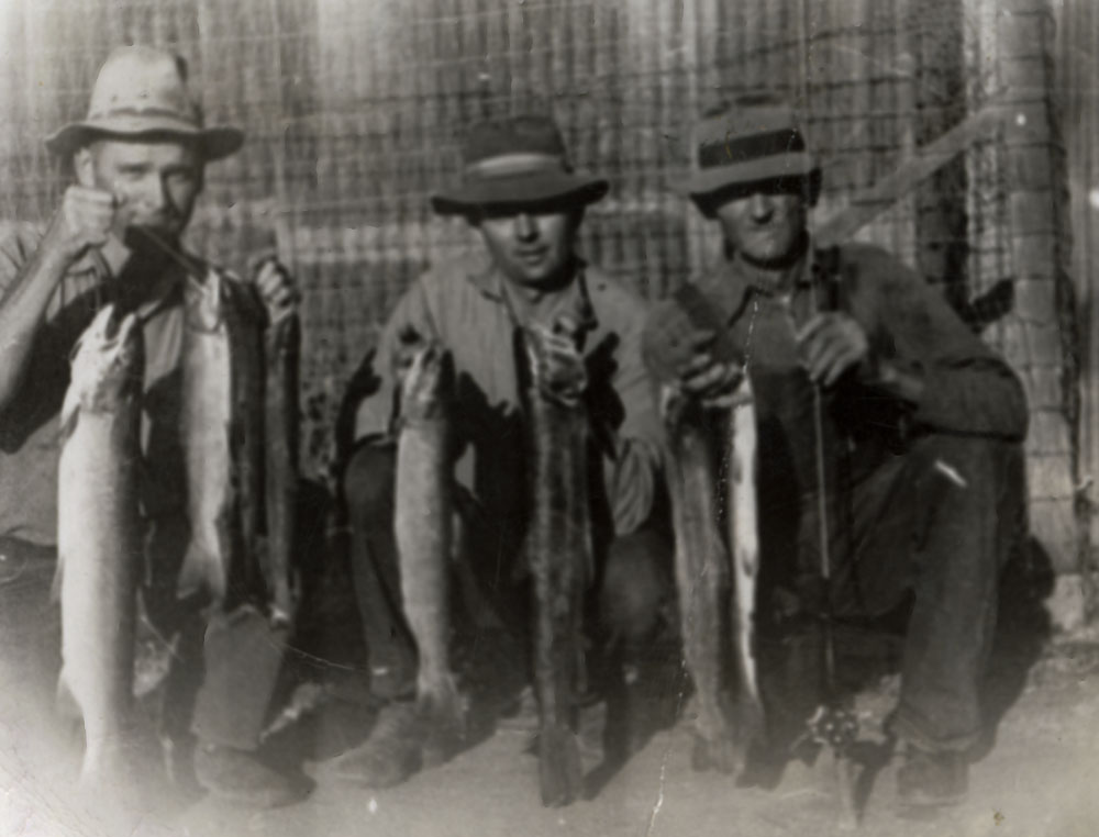 Gen, Bud, and Frank Ernst (far right) with one day's catch from Nacimento River at Big Hole where dam is now, 1943